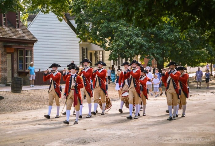 Soldiers marching through Colonial Williamsburg